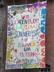 Einladungstransparent in der Sybelstraße
